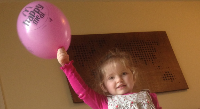 A Girl And Her Balloon
